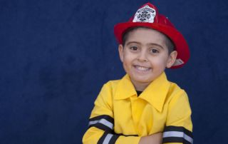 Boy with red fire helmet