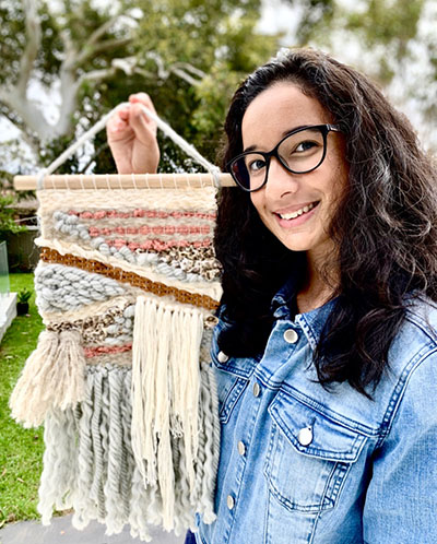 St Ursula's College Kingsgrove student Isabella Muslado with her wall hanging