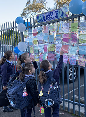 Our Lady of Lourdes Catholic Primary School Eastwood students look for their Blanket of Love patch