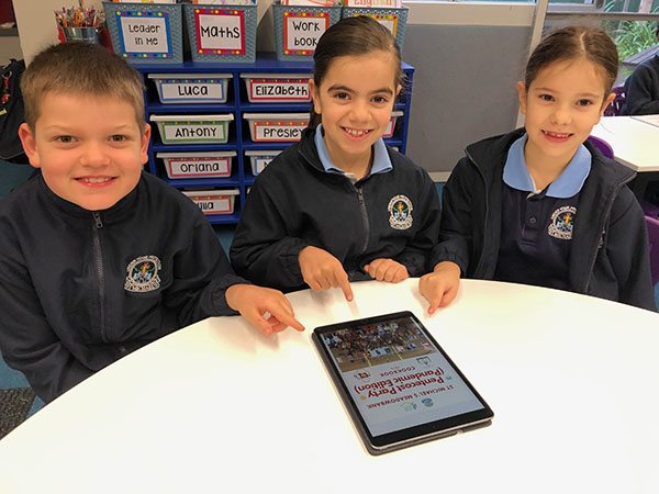 St Michael's Catholic Primary School Meadowbank Year 2 pupils Rafe, Gemma and Elena with the school's 2020 cookbook