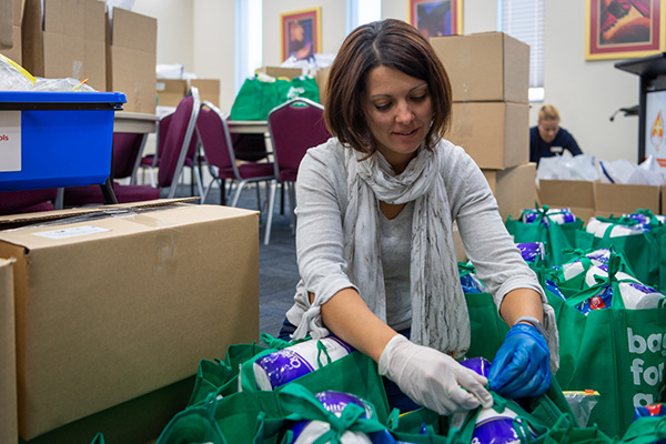 Sydney Catholic Schools Leader of Learning Early Learning, Sheree Rose helps pack education packs for refugee students.
