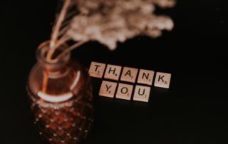 Thank you is spelled out with Scrabble tiles