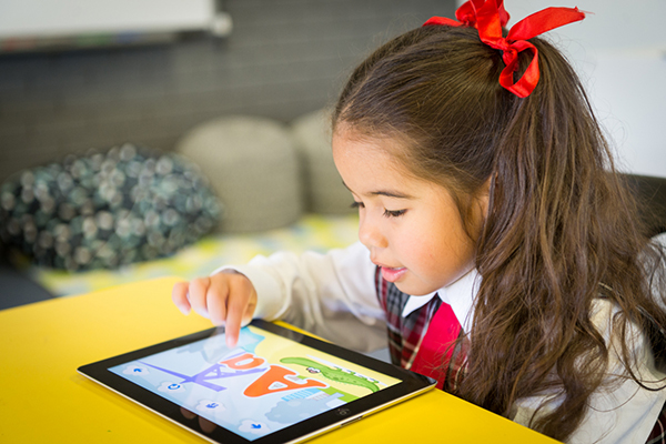 A primary school student uses a device to learn