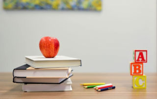 Australian-Primary-Principal's-Day apple on top of books