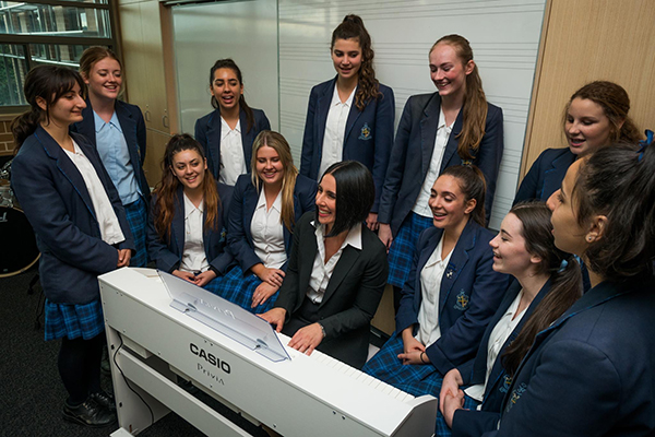 Eva Spata with award-winning acapella students at Marist Sisters' College Woolwich