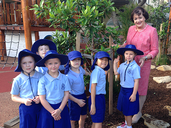 Long-serving St Mary's Catholic Primary School principal Beverly Coffey surrounded by her students