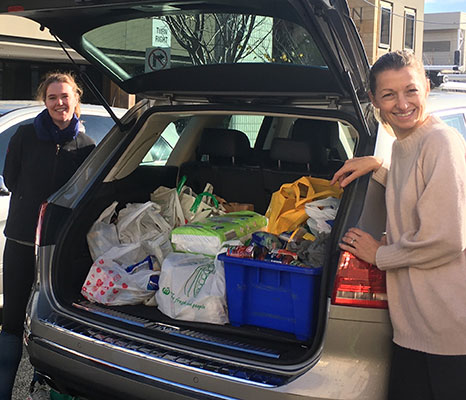 St Mary's Catholic Primary School North Sydney parents Eilish Reville and Felicity Clarkin loading up donations in the school carpark