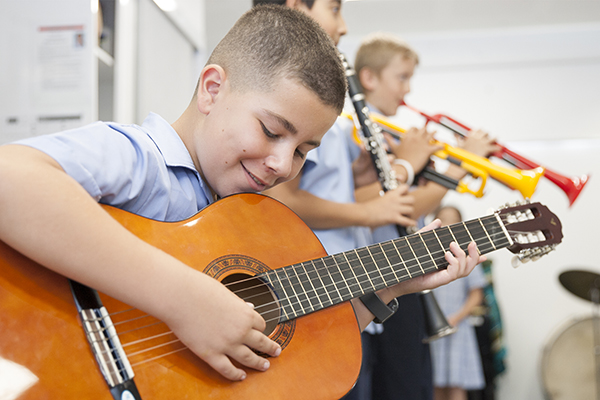 Primary school students practice their musical instruments