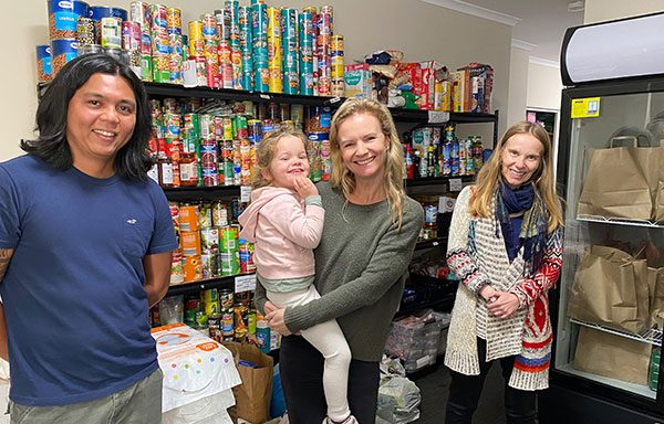 St Mary's Primary School North Sydney parents Jaytee Agapito and Amber Quin and child with Jesuit Refugee Service director Carolina Gottardo