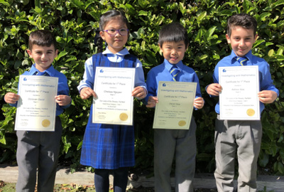 Our Lady of the Rosary Catholic Primary School Fairfield Year 1 maths competition winners hold up their certificates
