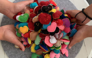 Students of Marion Catholic Primary School Horsley Park hold felt hearts made for staff at Fairfield Hospital