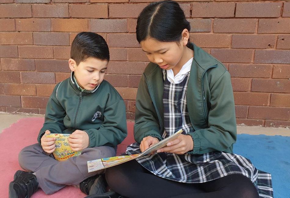 Our Lady of Fatima Primary School Kingsgrove students read a book together