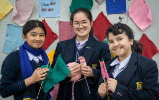 Bethlehem College Ashfield students Chloe Dionisio, Chloe Juwono and Zanthia Trava knitting together