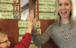 Sacred Heart Catholic Primary School Mosman Year 2 teacher, Miss Charlotte Allen high-fives a pupil