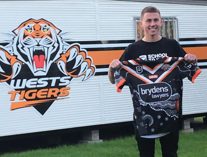 Marcellin College Randwick student Bill Reynolds with an NRL jersey he designed