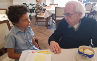 Pen pals Father Bernie and St Charles Catholic Primary School Ryde student Francis.