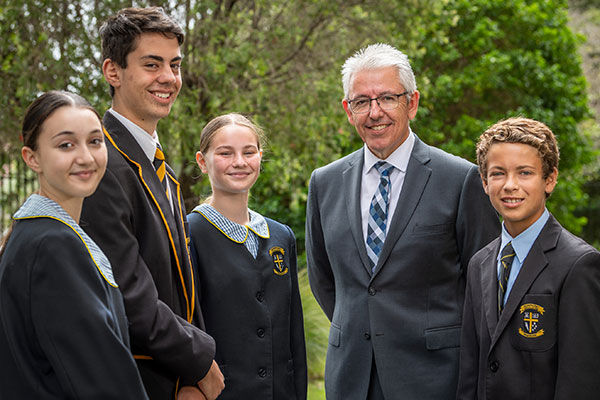 Principal-of-Champagnat-Catholic-College-Pagewood,-Craig-Mooney-and-students