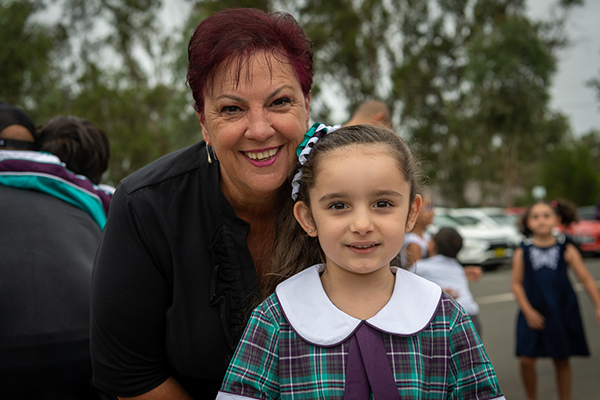 St Anthony of Padua Catholic College Austral principal Lea De Angelis with one of the school's new Kindy students.