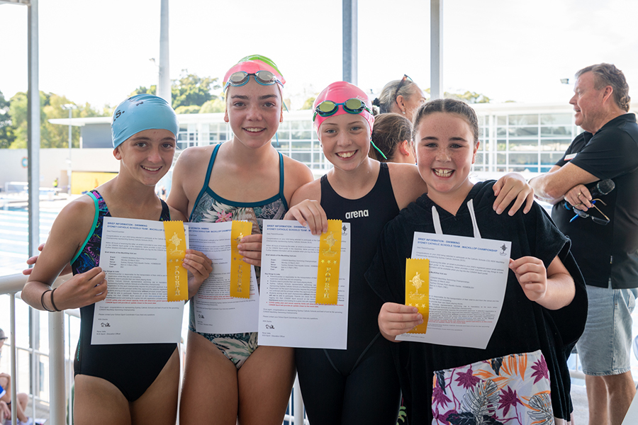Ribbon winners from SCS' 2021 Archdiocesan Swimming Carnival