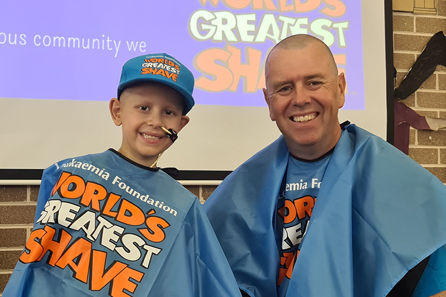 Pictured after his head shave is St Michael's Meadowbank principal Brian Story with Nicholas