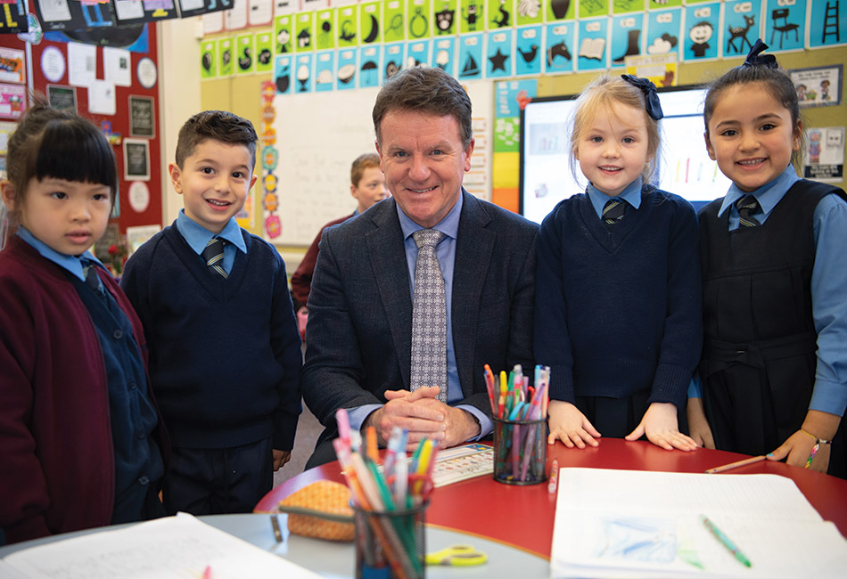Executive Director Tony Farley with students from Sydney Catholic Schools