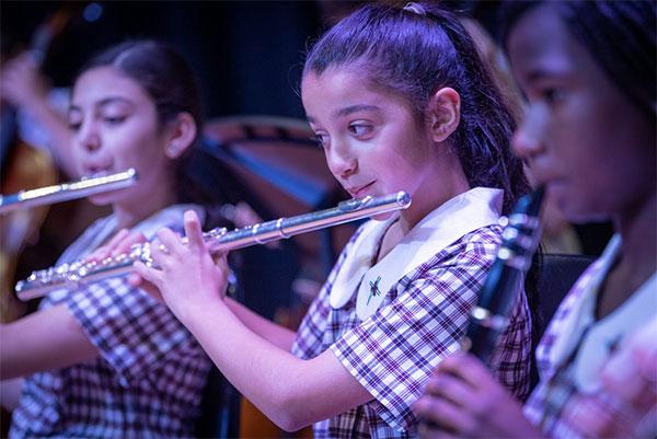 Amadeus-Holy-Spirit-Lakemba students playing musical instruments