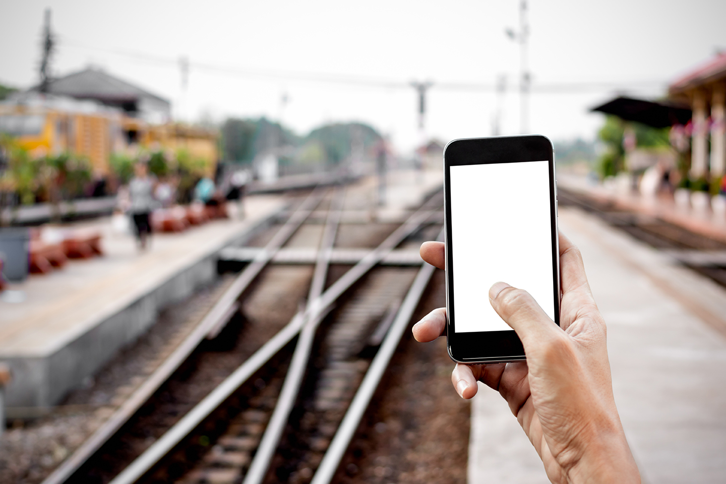 Commuter uses app at train station