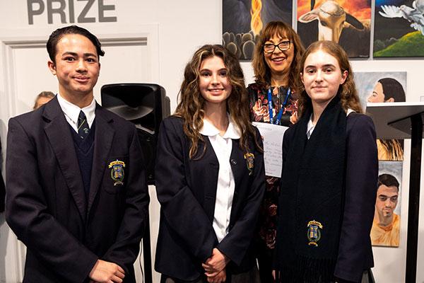 De La Salle College Cronulla students Sean Maquiran, Lily McAdam and Christina Stambolziovska accepting their Clancy Prize award