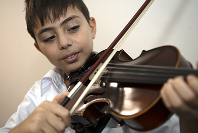 Holy Spirit Lakemba male student learns the violin