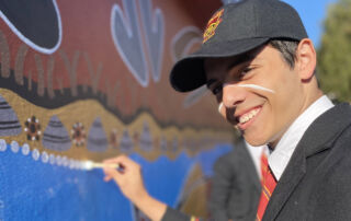Marist College Eastwood male student helps create an Indigenous mural