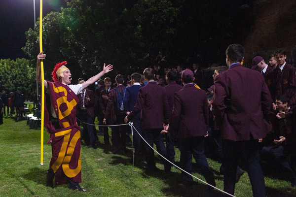 Holy Cross' gladiator mascot rallying the maroons fans