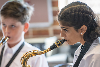 Trinity College Auburn Regents Park students playing instruments during Amadeus Music Program lessons