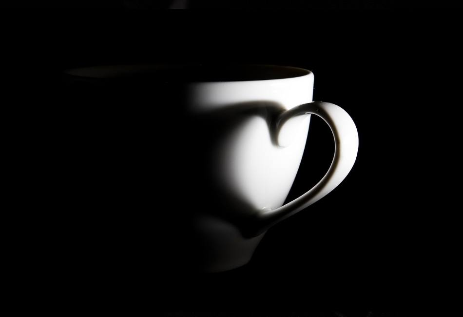Image of a cup with a love heart shadow