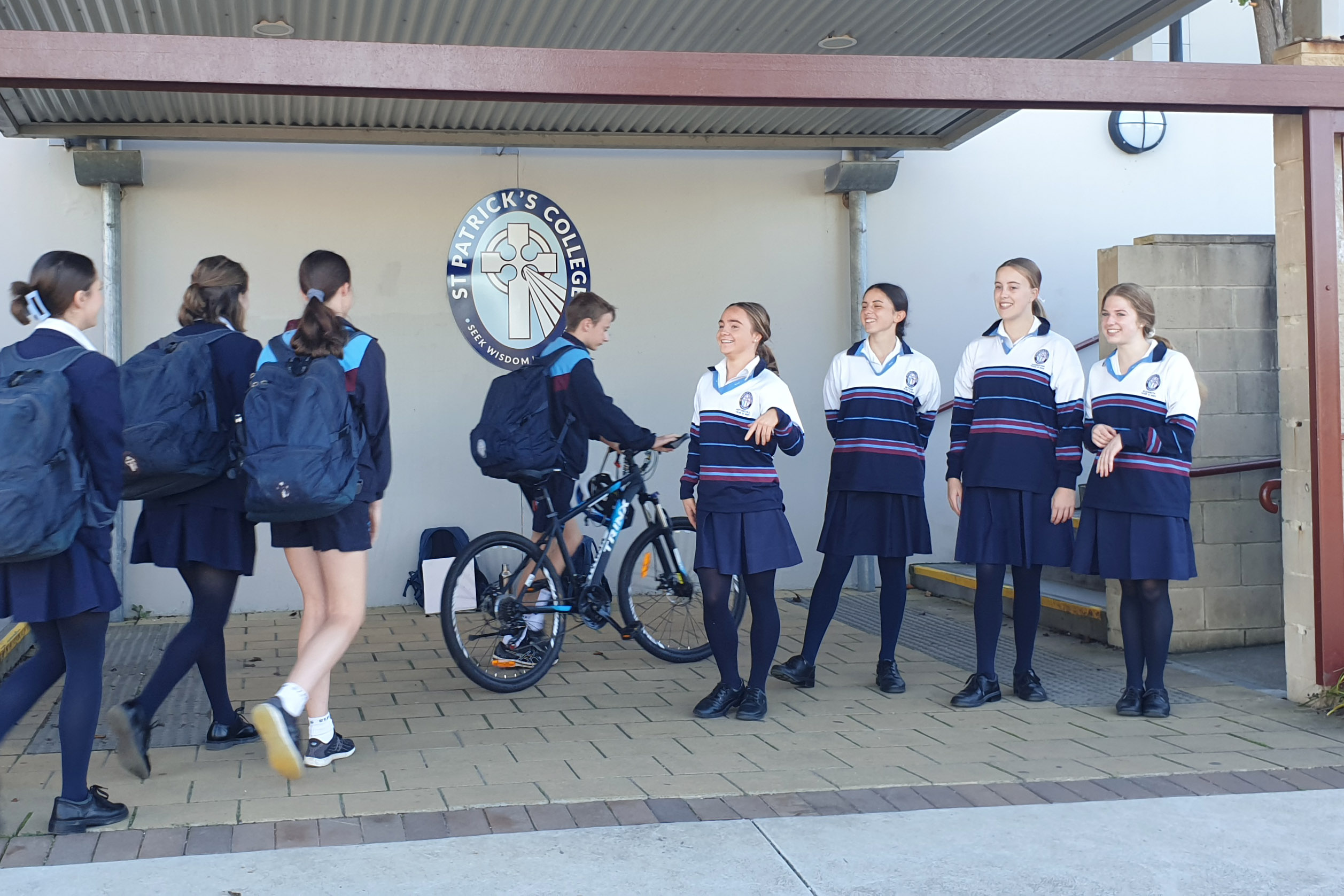 St Patrick's College students are greeted by their student leaders at the school gate on Feel Good Fridays