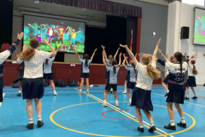 Students dance in their school hall on Feel Good Friday