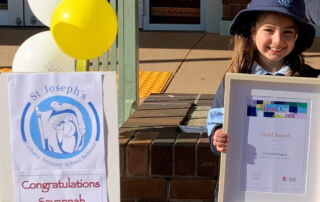 WriteOn 2020 winner Savannah with her writing awardfrom the NSW Education Standards Authority.