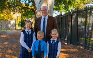 Sydney Catholic Schools' principal Bernard Ryan with students