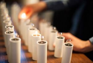 Students lighting a candle at church