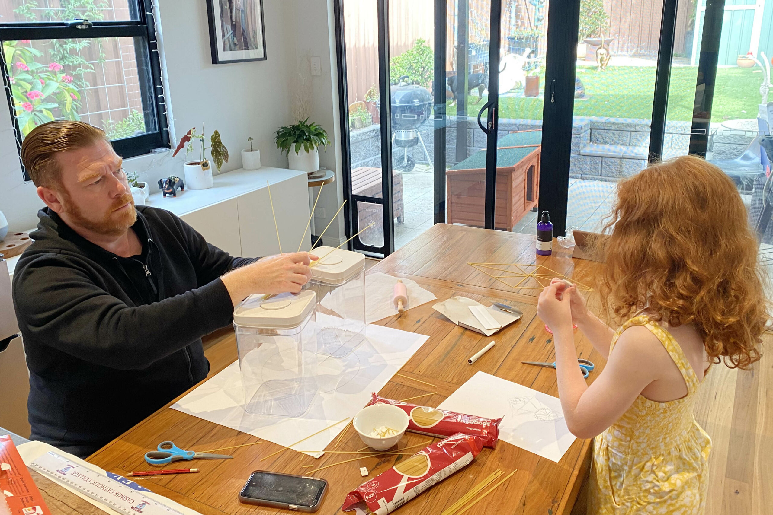 Father and daughter complete a STEM family challenge.