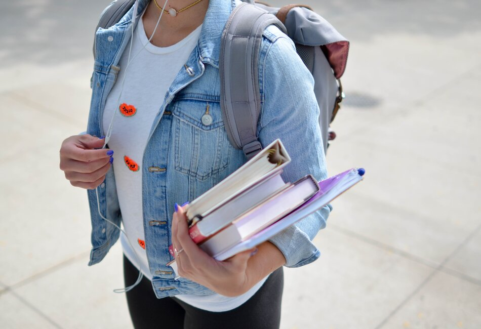 Woman holding text books