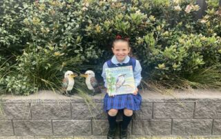 Chiara Castelvetere holds picture book Kookaburra