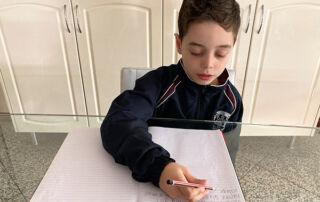 St Michael's Belfield student Leonardo Smith writing