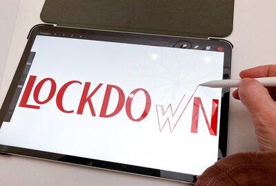 Word 'lockdown' drawn on an iPad