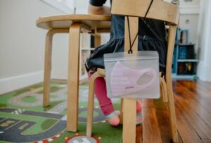 COVID mask hanging of student's chair